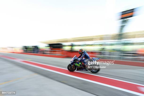 TOPSHOT Movistar Yamaha's Spanish rider Maverick Vinales rides his bike in the box during a free practice session of the San Marino Moto GP Grand...