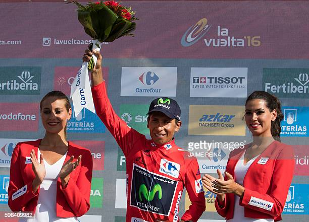 Movistar's Colombian cyclist Nairo Quintana celebrates on the podium after winning the red jersey during the 8th stage of the 71st edition of 'La...