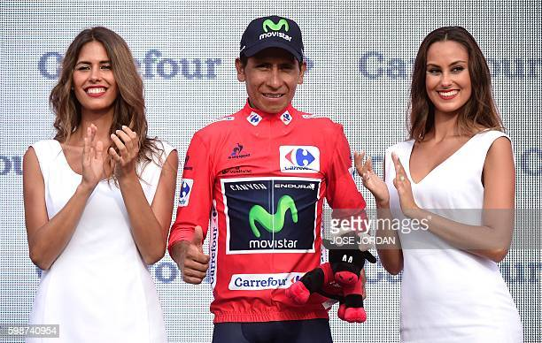 """Movistar's Colombian cyclist Nairo Quintana celebrates on the podium retainning the red jersey after the 13th stage of the 71st edition of """"La..."""