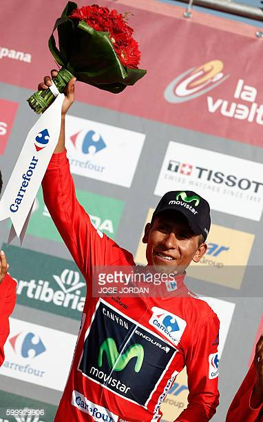 Movistar's Colombian cyclist Nairo Quintana celebrates on the podium after winning the red jersey during the 17th stage of the 71st edition of La...