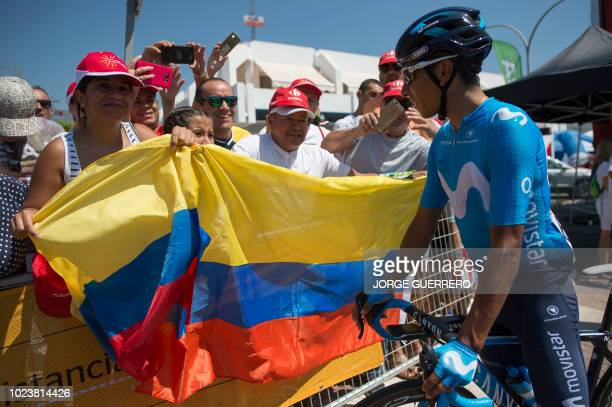 """Movistar's Colombian cyclist Nairo Quintana greets Colombian fans before the second stage of the 73rd edition of """"La Vuelta"""" Tour of Spain cycling..."""
