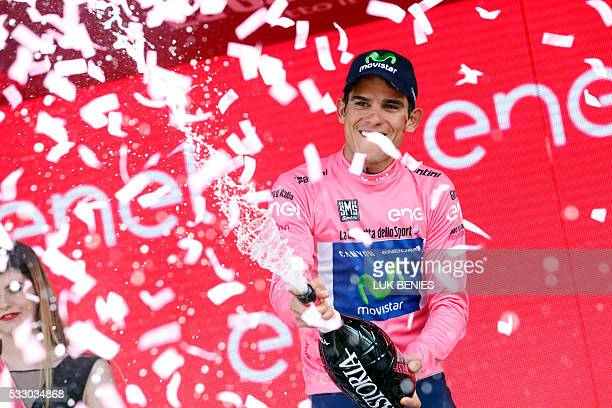 Movistar's Costa Rican rider Andrey Amador celebrates the pink jersey of the overall leader on the podium of the 13th stage of the 99th Giro...