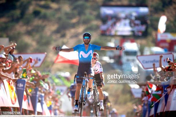 "Movistar's Spanish cyclist Alejandro Valverde celebrates as he crosses the finish line, winning the second stage of the 73rd edition of ""La Vuelta""..."