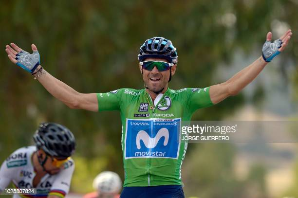 Movistar's Spanish cyclist Alejandro Valverde celebrates as he crosses the finish line winning the eighth stage of the 73rd edition of La Vuelta Tour...