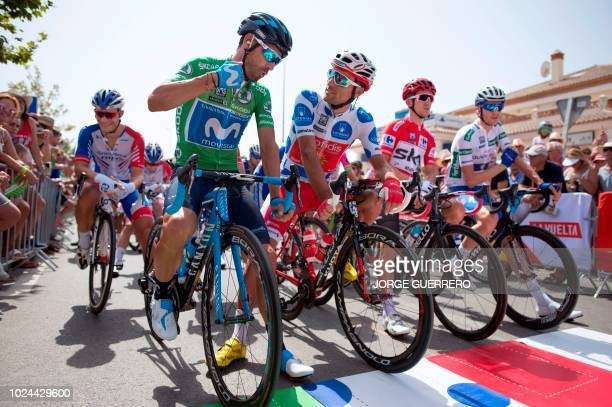 Movistar's Spanish cyclist Alejandro Valverde talks with Cofidis' Spanish cyclist Luis Angel Mate Mardones as they wait for for the start of the...