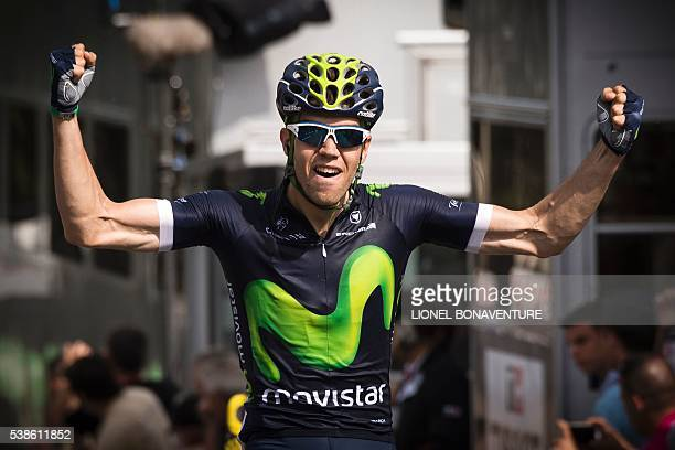 Movistar's Spanish rider Jesus Herrada celebrates as he crosses the finish line at the end of the third stage of the 68th edition of the Dauphine...