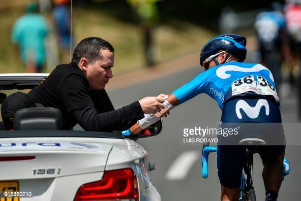 Movistar's Team Colombian cyclist Nairo Quintana receives medical attention as he competes during the third stage of the Colombia Oro y Paz 21...