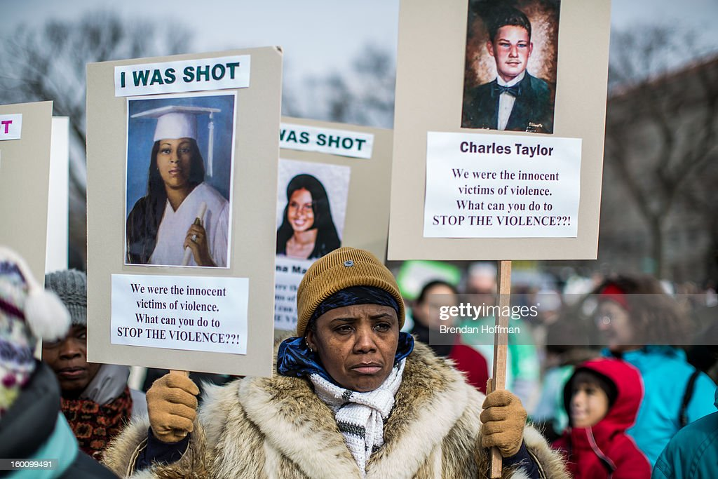 Movita Johnson-Harrell takes part in a march for stricter gun control laws on January 26, 2013 in Washington, DC. Demonstrators included survivors of the shooting at Virginia Tech, Newtown, Connecticut, and others.