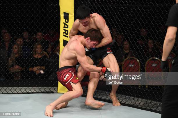 Movsar Evloev of Russia attempts to take down Seungwoo Choi of South Korea in their featherweight bout during the UFC Fight Night event at Yubileyny...