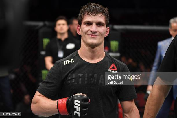 Movsar Evloev of Russia celebrates his victory over Seungwoo Choi of South Korea in their featherweight bout during the UFC Fight Night event at...