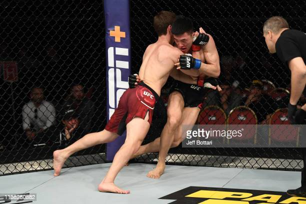 Movsar Evloev of Russia clinches with Seungwoo Choi of South Korea in their featherweight bout during the UFC Fight Night event at Yubileyny Sports...