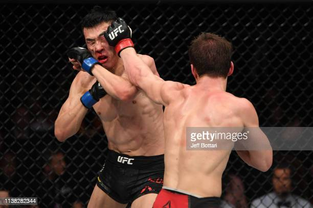 Movsar Evloev of Russia punches Seungwoo Choi of South Korea in their featherweight bout during the UFC Fight Night event at Yubileyny Sports Palace...
