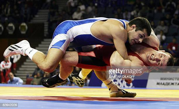 Movses Karapetyan of Armenia grabs Velin Marinov of Bulgaria during their GrecoRoman style 74 kilo final match at the European Championship in Varna...