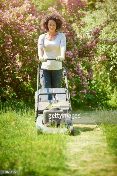 mowing the lawn - lawn stock photos and pictures