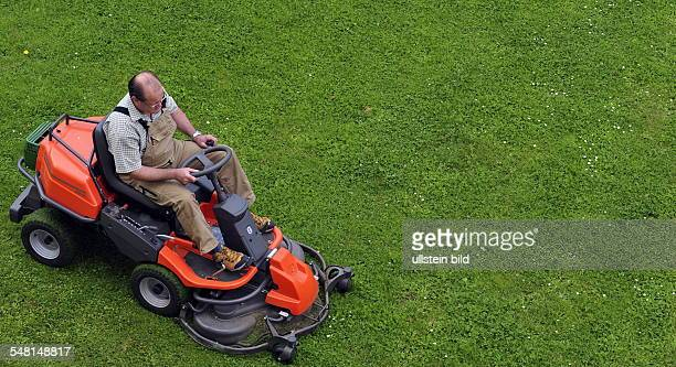 mowing the lawn with a lawn tractor