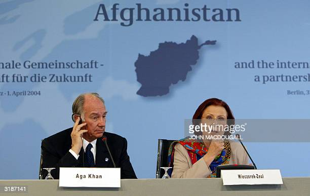 Mowlana Hazar Imam , the Aga Khan, and German Minister for Economic Cooperation Heidemarie Wieczorek-Zeul address a press conference during the...
