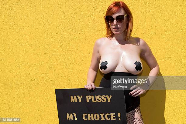Moxi Contin holds a sign during the 2nd Annual Amber Rose SlutWalk Festival in Los Angeles California October 1 2016 The event seeks to bring to an...