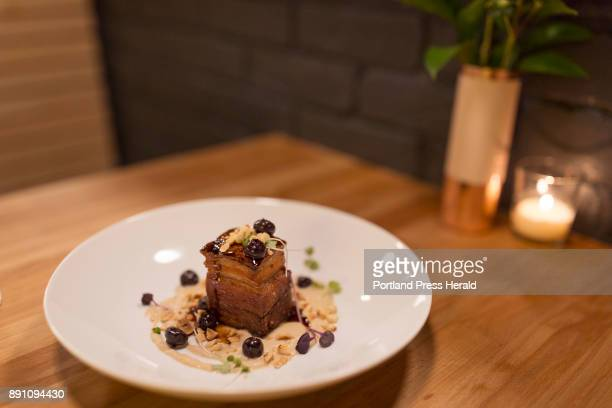 Moxiebraised pork belly with smoked onion purée pickled blueberries and toasted hazelnuts at Little Giant on Portland's West End