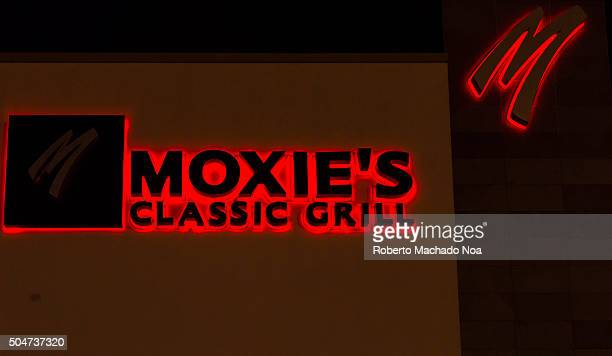 Moxie's Grill Bar sign outside a restaurant Moxie's is a casual dining restaurant operating in eight Canadian provinces The chain features extensive...