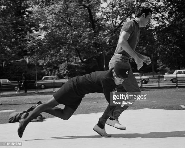 WPC Moya WoodHeath makes a flying tackle on a fugitive played by PC Geoff Aylen at a preview of the Metropolitan Police's 'Mansize '70 Exhibition' at...