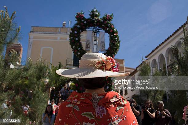 """Moza, Mayordoma from the Cross of """"La Fuente"""", praying in front of the Cross of """"Los LLanos"""", paying her respects and surrounded by photographers and..."""