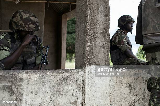 Mozambican Army soldiers stand at a checkpoint at the Vanduzi village on May 26 2016 in the Gorongosa area Mozambique Most of the population of...
