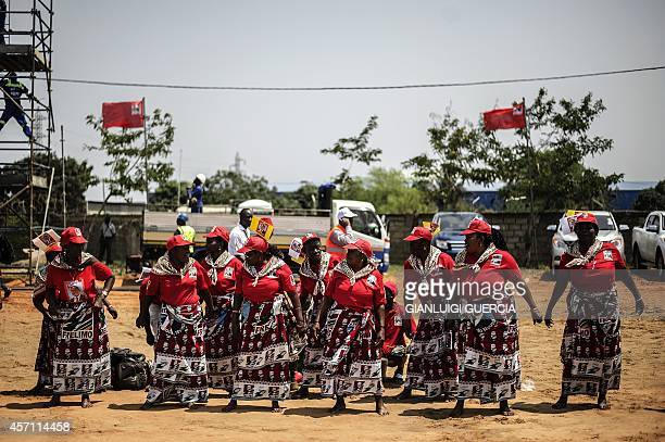 Mozambican Liberation Front presidential candidate Filipe Nyusi supporters cheer during the FRELIMO final presidential and legislative campaign rally...