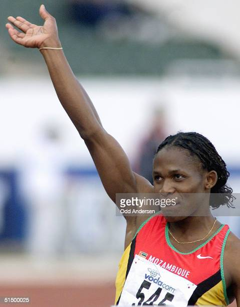 Mozambican Maria Mutola waves as she is introduced before the start of the 800 m semifinal at the All Africa Games at the Johannesburg stadium 17...