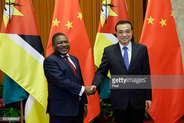 Mozambican President Filipe Nyusi meets China's Premier Li Keqiang at the Great Hall of the People in Beijing, China, May 19, 2016.