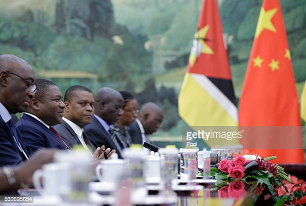 Mozambican President Filipe Nyusi talks with China's Premier Li Keqiang during a meeting at the Great Hall of the People in Beijing, China, May 19,...