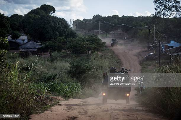 Mozambican regular army vehicles patrol the roads on the outskirts of Vanduzi village on May 26 2016 in the Gorongosa area Mozambique Most of the...