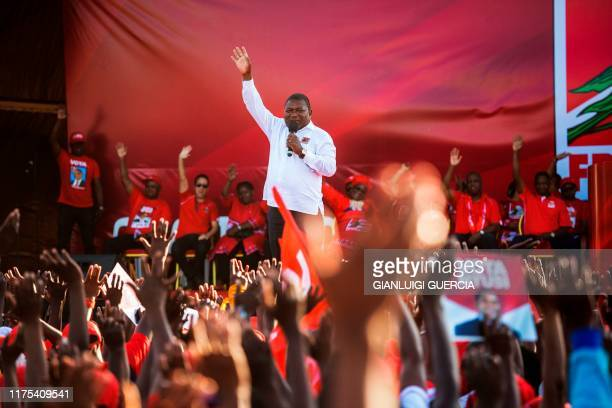 Mozambican ruling Party FRELIMO Presidential Candidate and Incumbent Mozambican President Filipe Nyusi gestures as he delivers a speech during his...
