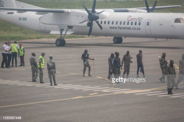 Mozambican soldiers are seen leaving the tarmac of the airport in Pemba on March 31, 2021. - Sporadic clashes broke out in Palma on Tuesday as...