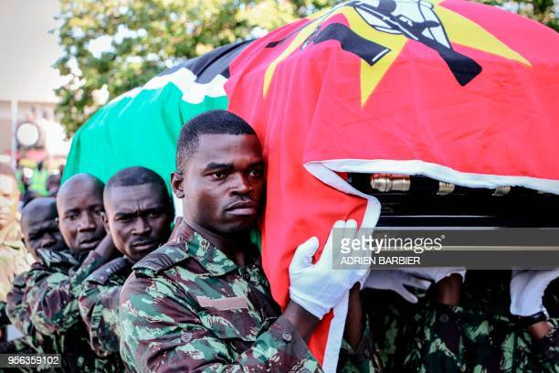 Mozambican Soldiers pallbearers carry the coffin of late Mozambican Opposition Party Mozambican National Resistance leader Afonso Dhlakama, drapped...