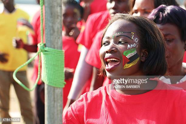 A Mozambican teenager celebrates with a Mozambican national flag painted on her face during the celebrations for the 40th anniversary of Mozambican...