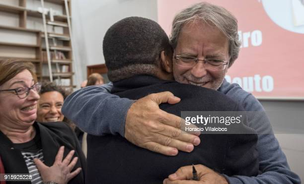 Mozambican writer Antonio Emlio Leite Couto, better known as Mia Couto, embraces a friend at the end of his speech in Camoes Institute program of...