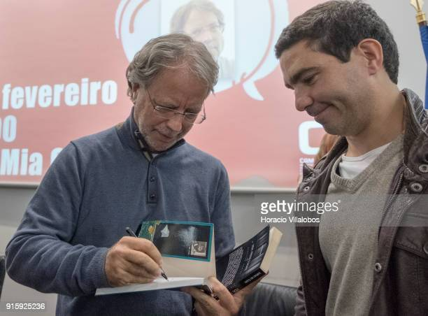 Mozambican writer Antonio Emlio Leite Couto better known as Mia Couto signs one of his books at the end of his speech in Camoes Institute program of...