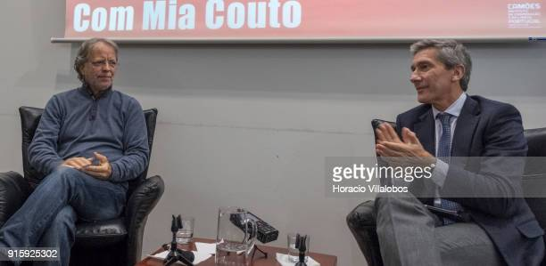 Mozambican writer Antonio Emlio Leite Couto , better known as Mia Couto, and the president of Camoes Institute Luis Faro Ramos applaud at the end of...