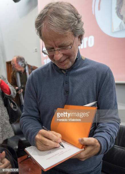 Mozambican writer Antonio Emlio Leite Couto, better known as Mia Couto, signs one of his books at the end of his speech in Camoes Institute program...