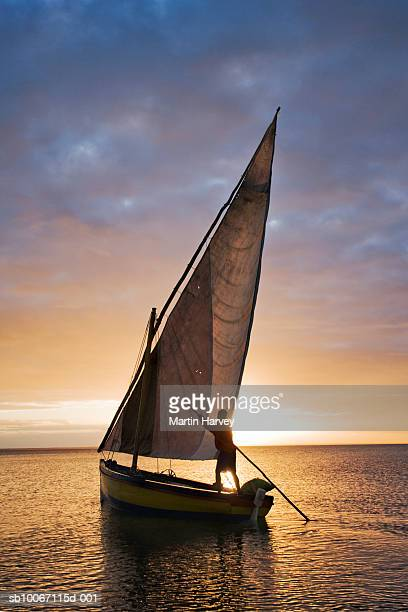 mozambique, benguerra lodge, traditional dhow at sunset - mozambique stock pictures, royalty-free photos & images