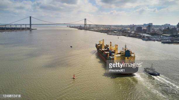 mozambique, maputo, aerial view of container ship leaving city - mozambique stock pictures, royalty-free photos & images