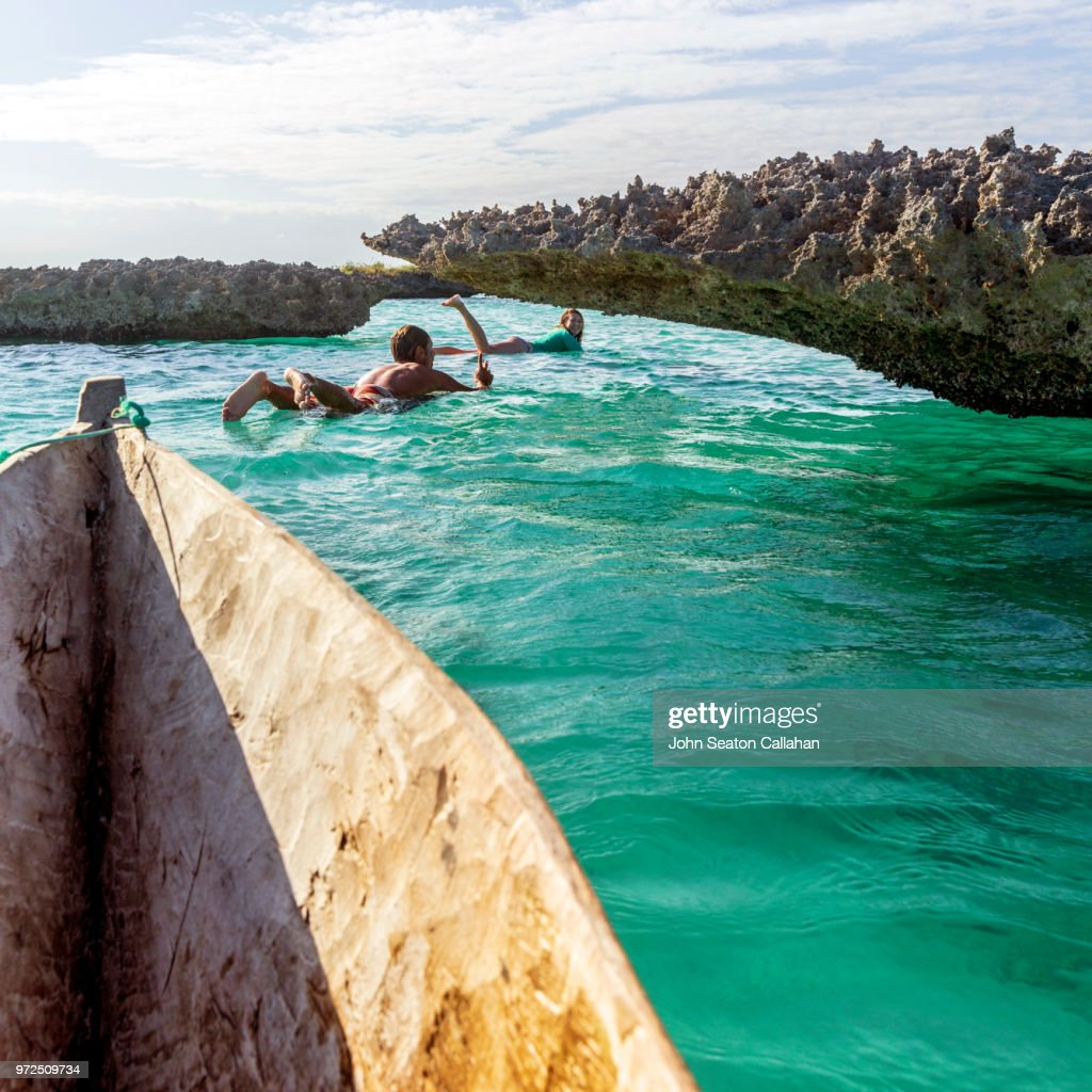Mozambique, Mossuril District, surfers : Stock Photo
