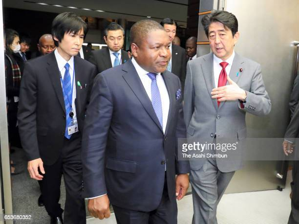Mozambique President Filipe Jacinto Nyusi and Japanese Prime Minister Shinzo Abe attend a press conference following their meeting at Abe's official...