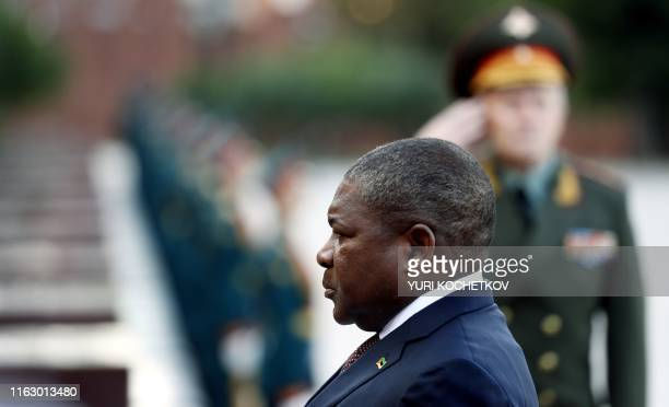 Mozambique President Filipe Nyusi attends a wreath laying ceremony at the Tomb of the Unknown Soldier in central Moscow, on August 21 as part of his...