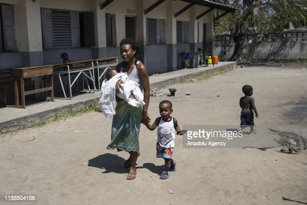 Mozambiquean woman is seen with her children after taking shelter at Manga Olofforte school following the Cyclone Idai in Beira, Mozambique on March...