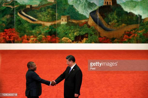 Mozambique's President Filipe Nyusi, left, shakes hands with Chinese President Xi Jinping during the Forum on China-Africa Cooperation held at the...
