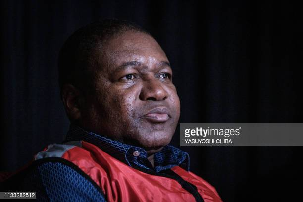 Mozambique's President Filipe Nyusi looks on during a meeting with businessmen from different sectors in Beira, Mozambique, on March 27, 2019.