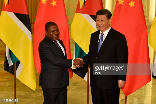 Mozambique's president Filipe Nyusi shakes hands with Chinese president Xi Jinping before their meeting at the Great Hall of the People in Beijing,...
