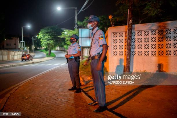 Mozammbique Police officers stand guard during the start of the curfew in Maputo on February 6, 2021. - About two million Mozambicans in the...