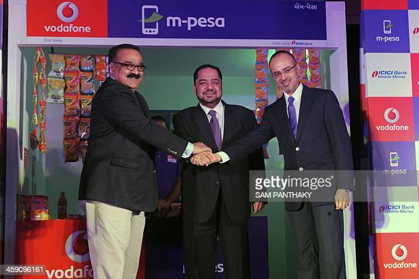 MPesa Vodafone India's Business Head Suresh Sethi Vodafone India's Operations Director BP Singh and Vodafone India Gujarat's Business Head Brajesh...